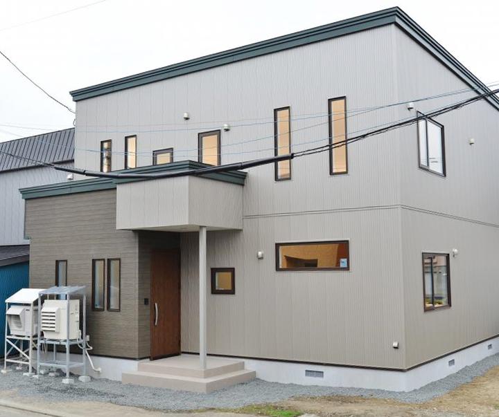 柔らかな風合いの二世帯住宅